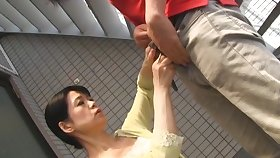Japanese mature spreads her paws to ride a gumshoe on the bed