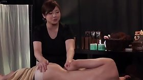 Chubby Japanese babe moans while being fucked on a massage table