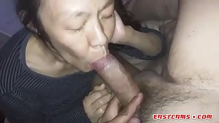 Amateur Asian Mature sucking big cock
