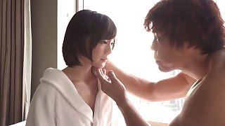 Sultry Japanese babe in a hotel room fucks hardcore